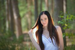 Portrait of a beautiful young woman in forest Stock Photo