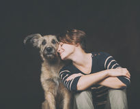 Portrait of a beautiful young woman with a funny shaggy dog on a Royalty Free Stock Images