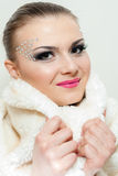 Beautiful smiling girl with a white fur hood Stock Photo