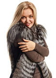 Portrait of a beautiful young woman in a fur vest Royalty Free Stock Photography