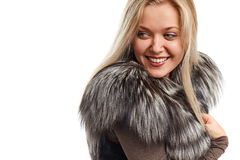 Portrait of a beautiful young woman in a fur vest Stock Image