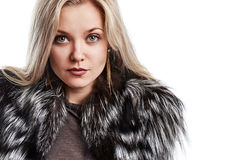 Portrait of a beautiful young woman in a fur vest Stock Images