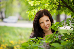 Portrait Beautiful young woman in a garden. Royalty Free Stock Photos