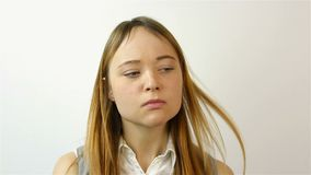 Portrait of a beautiful young woman. The gesture of chagrin Portrait of a beautiful young woman. A gesture of grief. Portrait of a beautiful young woman. A stock video
