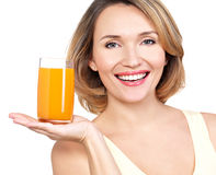 Portrait of a beautiful young woman with a glass of juice. Stock Image