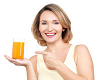 Portrait of a beautiful young woman with a glass of juice. Royalty Free Stock Photography