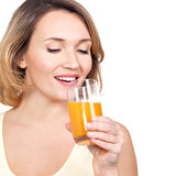 Portrait of a beautiful young woman with a glass of orange juice Royalty Free Stock Images