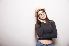 Portrait of beautiful young woman in glasses and funky hat Royalty Free Stock Photography
