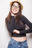 Portrait of beautiful young woman in glasses and funky hat Stock Images