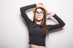 Portrait of beautiful young woman in glasses and funky hat Stock Photo