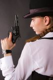 Portrait of beautiful young woman with a gun. Stock Photos