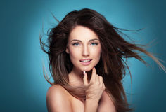 Portrait of a beautiful young woman with hair flying. Stock Images