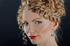 Portrait of beautiful young woman with hairdo Royalty Free Stock Photo