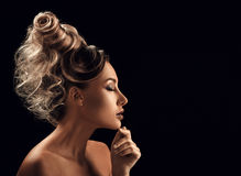 Portrait of Beautiful Young Woman with hairstyle touching her fa Stock Images