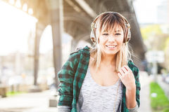 Portrait of a beautiful young woman in Hamburg listening music Stock Photo