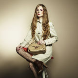 Portrait of a beautiful young woman with a handbag Stock Photography