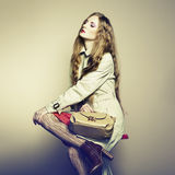 Portrait of a beautiful young woman with a handbag Royalty Free Stock Photos