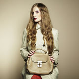 Portrait of a beautiful young woman with a handbag Royalty Free Stock Images