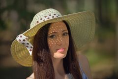 Portrait of a beautiful young woman with hat in forest Royalty Free Stock Image