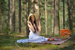 Portrait of a beautiful young woman with hat in forest Stock Photo