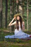 Portrait of a beautiful young woman with hat in forest Royalty Free Stock Images
