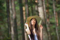 Portrait of a beautiful young woman with hat in forest Stock Photos