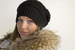 Portrait of beautiful young woman in hat and fur Stock Photos