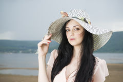 Portrait of a beautiful young woman in hat in summer Royalty Free Stock Photography