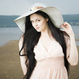 Portrait of a beautiful young woman in hat in summer Stock Image