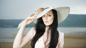 Portrait of a beautiful young woman in hat in summer Stock Photo