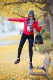Beautiful young woman having fun in the autumn. Stock Image