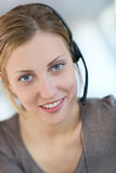 Portrait of beautiful young woman with headset Royalty Free Stock Photos