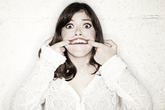 Forcing Mouth Wide-Open Royalty Free Stock Photos