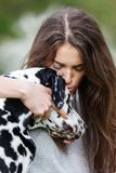 Portrait of a beautiful woman with her Dalmatian dog. Portrait of a beautiful young woman with her Dalmatian dog Royalty Free Stock Photos
