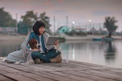 Young woman with her dog using digital tablet royalty free stock photos