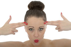 Portrait Of A Beautiful Young Woman With Her Fingers Against Her. Forehead As Make Believe Guns Stock Photography