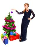 Portrait of a beautiful young woman holding a bauble near the Ch. Ristmas tree isolated over white background Stock Photography