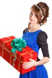 Portrait of a beautiful young woman holding a big gift Royalty Free Stock Images