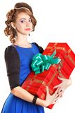 Portrait of a beautiful young woman holding a big gift Royalty Free Stock Photography