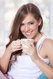 Portrait of a beautiful young woman holding a cup Royalty Free Stock Photos