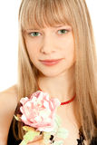 Portrait of beautiful young woman holding a flower Stock Image