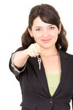 Portrait of beautiful young woman holding key Stock Photography