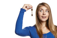 Woman holding key, looking at it Stock Image