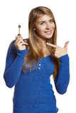 Woman showing house key Royalty Free Stock Image