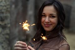 Woman holding little lights Royalty Free Stock Image