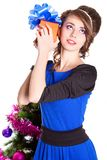 Portrait of a beautiful young woman holding a present Stock Image