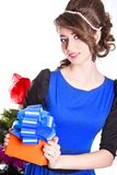 Portrait of a beautiful young woman holding a present Royalty Free Stock Photos