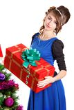 Portrait of a beautiful young woman holding a present near the C Stock Photography