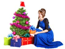 Portrait of a beautiful young woman holding a present near the C Royalty Free Stock Photos