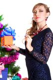 Portrait of a beautiful young woman holding a present near the C Stock Photo